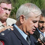 Dennis Wells backed by colleagues including Merv Neil (left), in 2009.