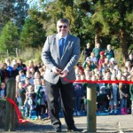 Mayor Allan Sanson cuts the ribbon to open the walkway