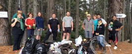 The geocachers with the trash hauled out of the Tamahere Reserve on Anzac Day