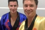 Eli and Sam Thomas in traditional Vietnamese robes, on their fundraising journey