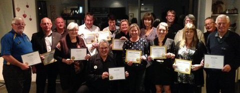 The first local Lions with their membership certificates