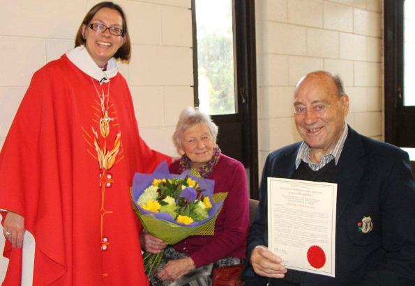 Christine and Rex Pickering receive a letter of thanks from Bishop Helen-Ann Hartley
