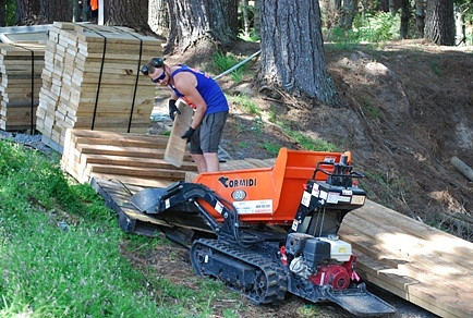 Timber for the Tamahere Reserve boardwalk being taken to the site.