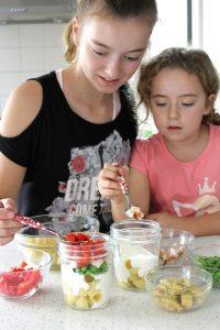 Kids build salad in a jat